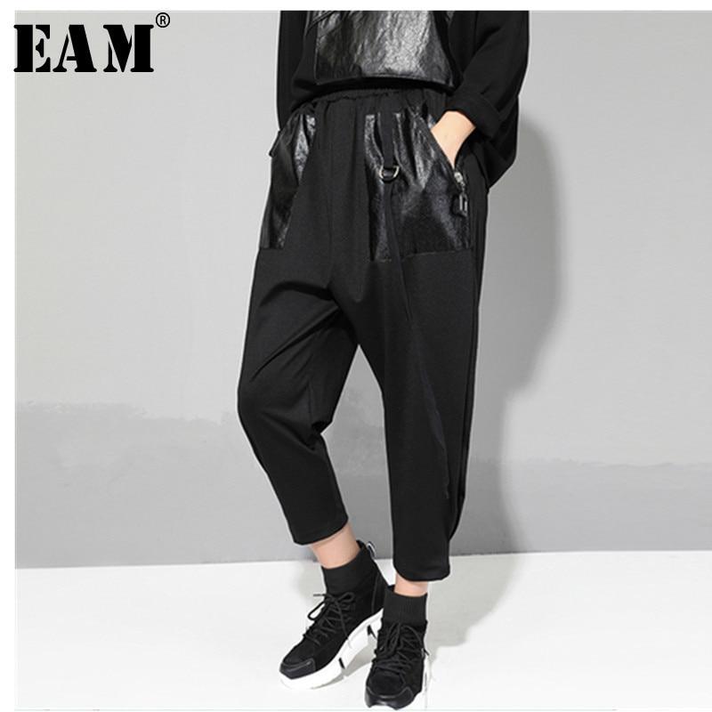 [EAM] 2020 New Spring Autumn High Elastic Waist Black Pu Pocket Split Joint Loose Harem  Pants Women Trousers Fashion Tide JR360