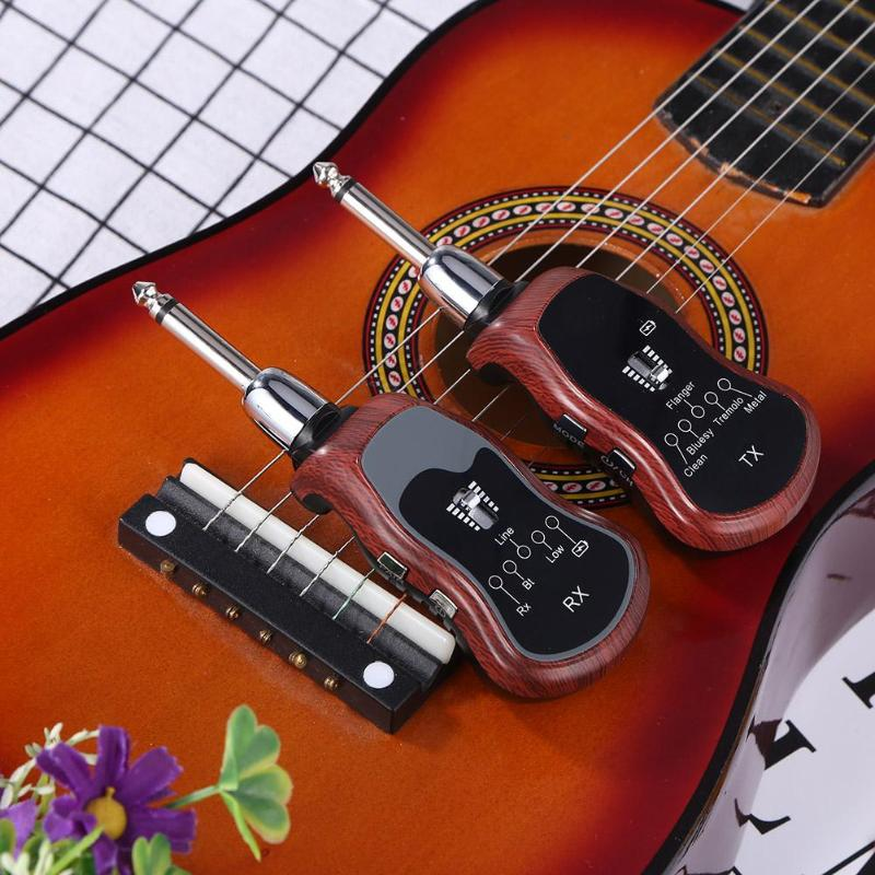 UHF Wireless Guitar Wireless System Transmitter+Receiver for Guitar Violin Electric Instrument Built-in 5 EffectsUHF Wireless Guitar Wireless System Transmitter+Receiver for Guitar Violin Electric Instrument Built-in 5 Effects