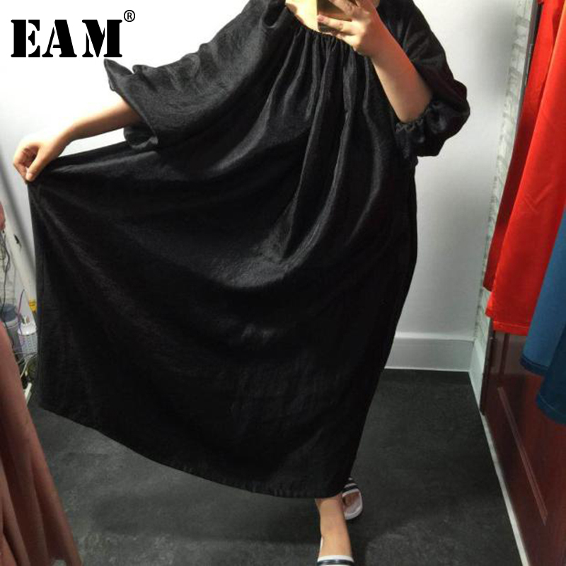 EAM 2019 Spring Summer Woman Personality Black Color Half Puff Sleeve O neck Backless Pleated