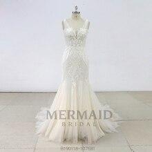 Nuovo backless in rilievo pesante mermaid abito da sposa 2019