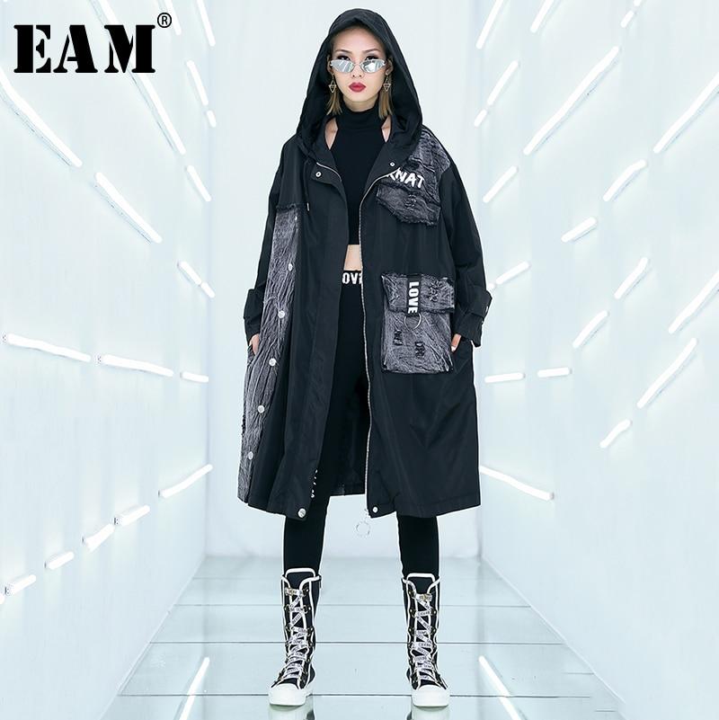 [EAM]2019 New Spring Summer Hooded Long Sleeve Black Letter Printed Pocket Denim Big Size Windbreaker Women   Trench   Fashion JQ040