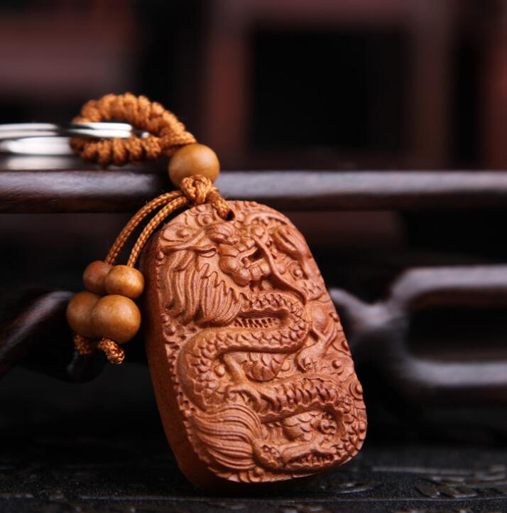 Chinese Peach Wood Carved Safe And Auspicious Word Animal Dragon Wealth Luck Exquisite Car Key Chain Pendant