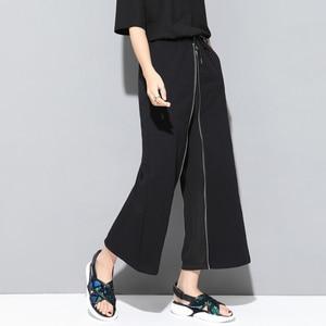 Image 2 - [EAM] 2020 חדש אביב סתיו גבוהה אלסטי מותניים שחור רוכסן פיצול משותף אישיות Loose מכנסיים נשים מכנסיים אופנה JS994