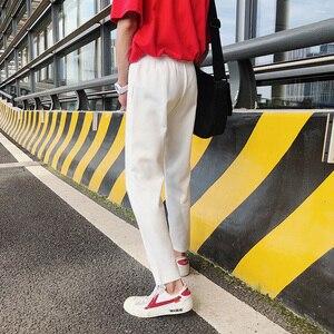 Image 4 - Pantalon pour homme, tendance, confortable, grande taille, 2020, en coton doux, couleur blanc/noir, collection pantalons décontractés