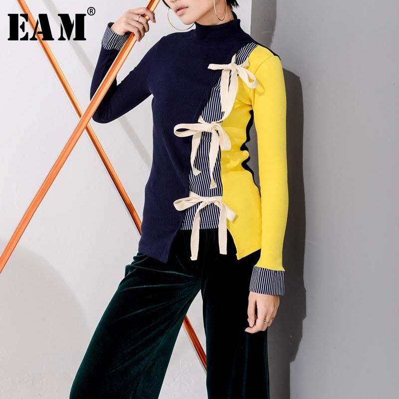 [EAM] 2020 New Spring High Collar Long Sleeve Hit Color Loose Bandage Bow Hollow Out Knitting Sweater Women Fashion Tide JL901