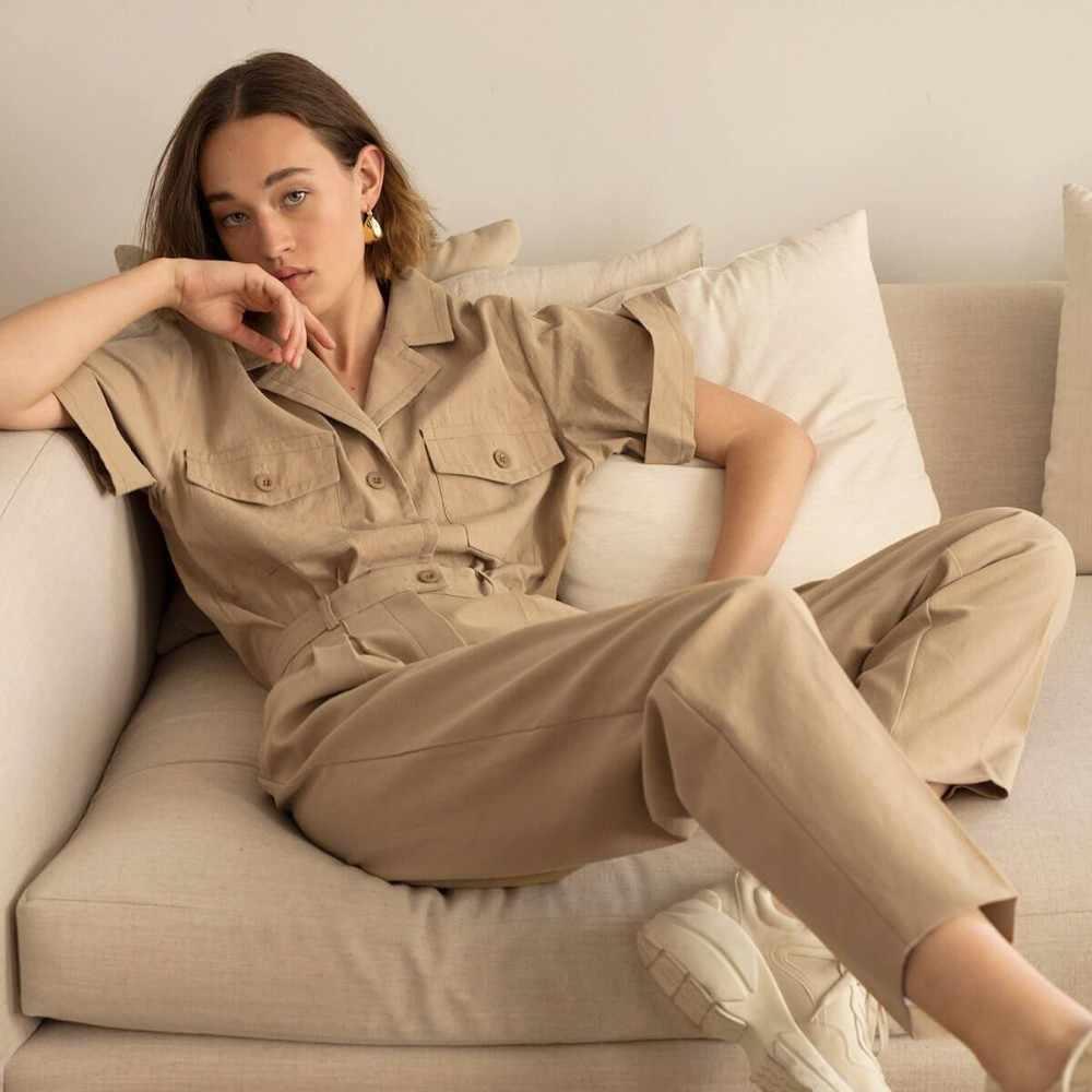Hdy haoduoyi cor sólida bonito camisas gola multi-bolso decorativo femme neutro topos moda feminina outwears