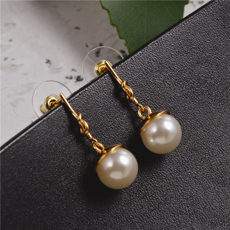 European and American French knotted pearl earrings female niche design simple temperament earrings