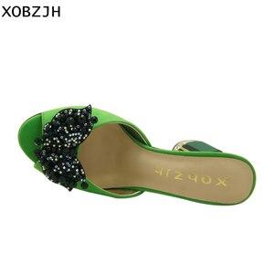 Image 4 - Sandalias verdes con diamantes de imitación para mujer, zapatos de lujo sin cordones, de tacón alto, color verde, para verano, 2019