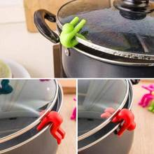 1pc Creative Small Man Anti-overflow Pot Rack Silicone Multi-functional Phone Bracket Universial Home Kit Kitchen Cooking Tool(China)
