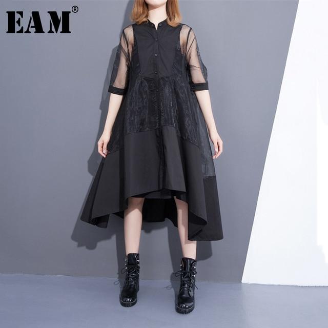 [EAM] 2020 חדש קיץ צווארון עומד שלושה רובע שרוול שחור Oragnza רשת תפר רופף שתי חתיכה שמלת נשים אופנה T456