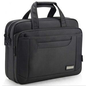 Image 1 - OYIXINGER 2020 avukat evrak çantası erkekler bilgisayar el çantaları lüks marka erkek iş çantası Oxford su geçirmez ofis çalışma için Maletas