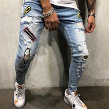 13bf87adfebc3 MR K Jeans de hombre Hip Hop pantalones delgados cinturón insignia hombres  agujero Jeans azul negro hombre jeans