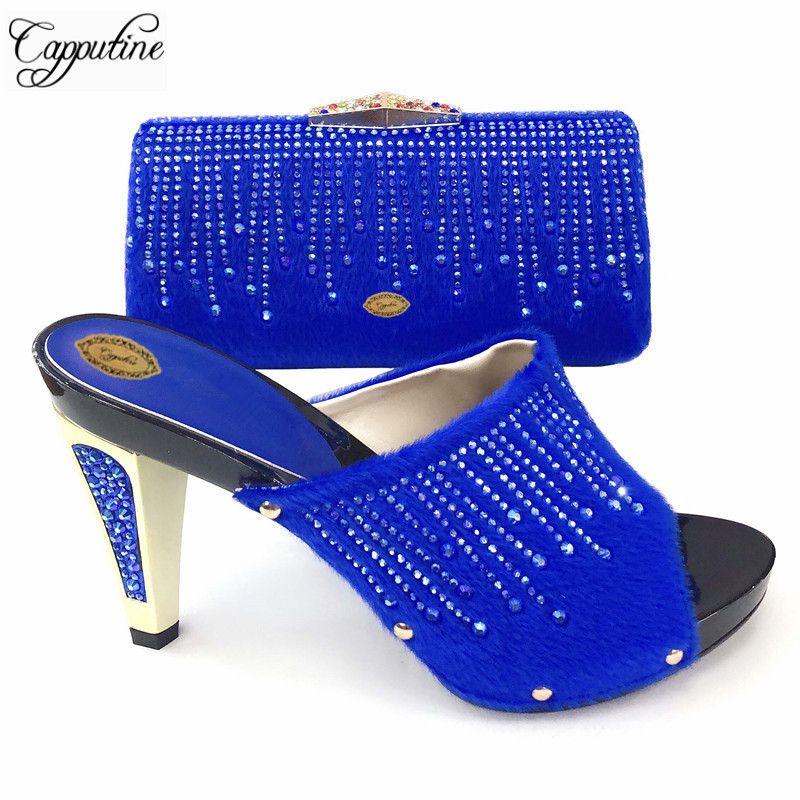 Capputine Blue Color Flock And Stone Shoes And Bag To Match For Parties Nigeria Style High Heels Shoes And Bag Set Size 37-43Capputine Blue Color Flock And Stone Shoes And Bag To Match For Parties Nigeria Style High Heels Shoes And Bag Set Size 37-43