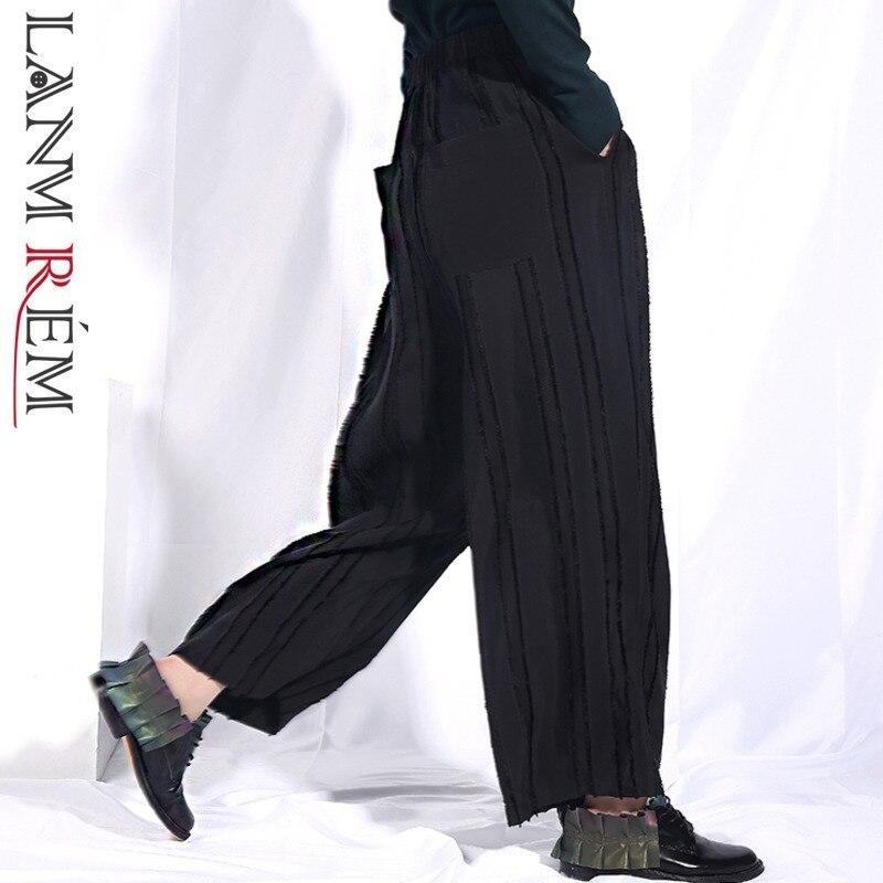 LANMREM Новинка 2019 года для женщин весна Высокая Эластичный Талия черный разделение совместных широкие брюки Модные женские низ свободные шта