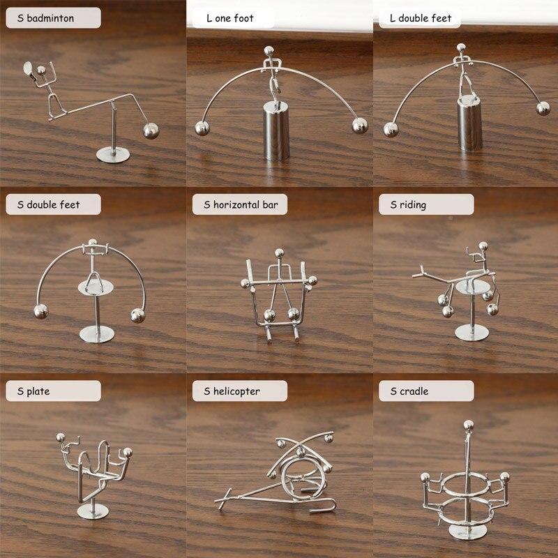 Bola de equilibrio decoración para el Hogar pequeño hombre de hierro levantamiento de pesas