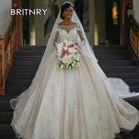 bcce8a6009565 BRITNRY 2019 Long Sleeves Luxury Princess Wedding Dresses Ball Gown Wedding  Dress Lace Appliqued Dubai Arabic
