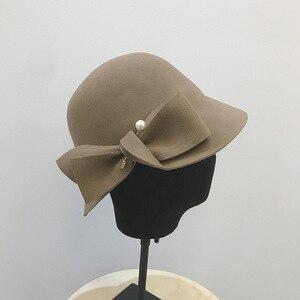 Image 2 - 2019 herbst Und Winter Neue Eimer Becken Von Bowknot Perle Wolle Hut Weibliche Warme Mode Weibliche Warme