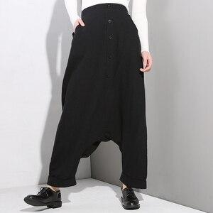 Image 2 - [EAM] 2020 New Spring Autumn High Elastic Waist Black Button Split Joint Thin Loose Cross pants Women Trousers Fashion Tide YG25