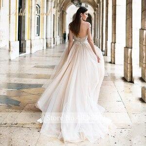 Image 2 - Ashley Carol Backless Appliques A Line Wedding Dress 2020 Beaded V neckline Sleeveless Chapel Train Bridal Gown Vestido de Novia