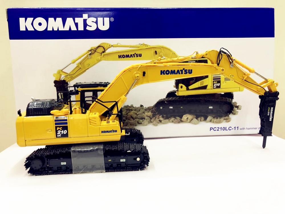 UNIVERSAL HOBBIES KOMATSU PC 210 EXCAVATOR WITH HAMMER DRILL 1:50 SCALE 8096