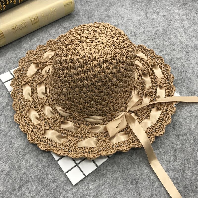 2019 Korean Wide Brim Straw Hats Women Hollow Out Beach Sunhat Ladies Sun Hat Summer Caps Fluff Rope Piercing Bowknot Sunhat