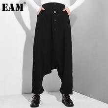 [EAM] 2020 חדש אביב סתיו גבוהה אלסטי מותניים שחור כפתור פיצול משותף דק רופף צלב מכנסיים נשים מכנסיים אופנה גאות YG25