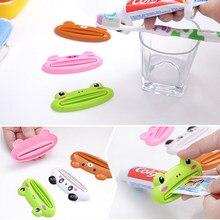 1pc lindo tubo de animales exprimidor de pasta de tubo de dibujos animados dispensador de pasta de dientes rodante sostenedor de baño productos básicos