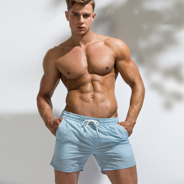 ccec2a8172f7 2019 Mens Sexy Swimsuit Swimwear Men Briefs Men Swimming Shorts Beach Shorts  Sports Suits Surf Board