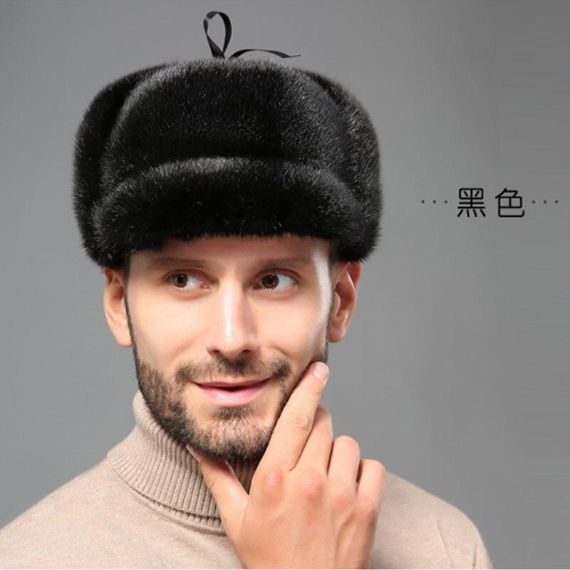 fe27ac78d409 YECHNE hombre invierno Rusia estilo earrap Piel de visón genuino bombardero  gorra gruesa cuero ...
