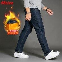 Los hombres de los pantalones vaqueros de terciopelo gran tamaño  engrosamiento cintura alta pantalones gruesos grasa suelta Homb. e054080e7d55