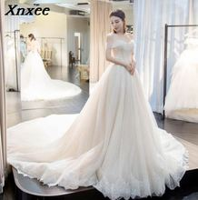 Xnxee White Lace Appliques Ball Gown Cheap  Dresses 2019 Xnxee Off The Shoulder Short Sleeves Bridal Dresses Gowns Xnxee black lace details off the shoulder short sleeves bodysuits