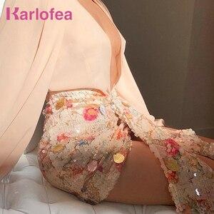 Image 1 - Karlofea אלגנטי פרחוני נצנצים חצאיות נשים שיק סימטרי קדמי זרוק עטוף מיני לעטוף חצאית סקסית מועדון מסיבת תלבושות חצאית