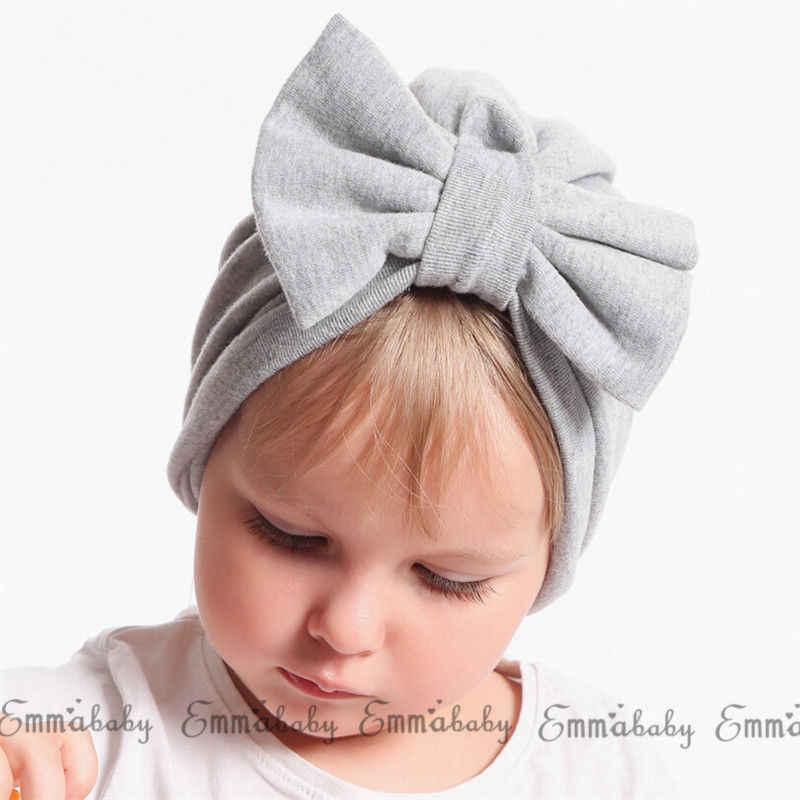 2018 nuevo bebé recién nacido niña turbante cómodo Floral Bowknot gorra de Hospital de algodón gorro de lana regalos al por mayor