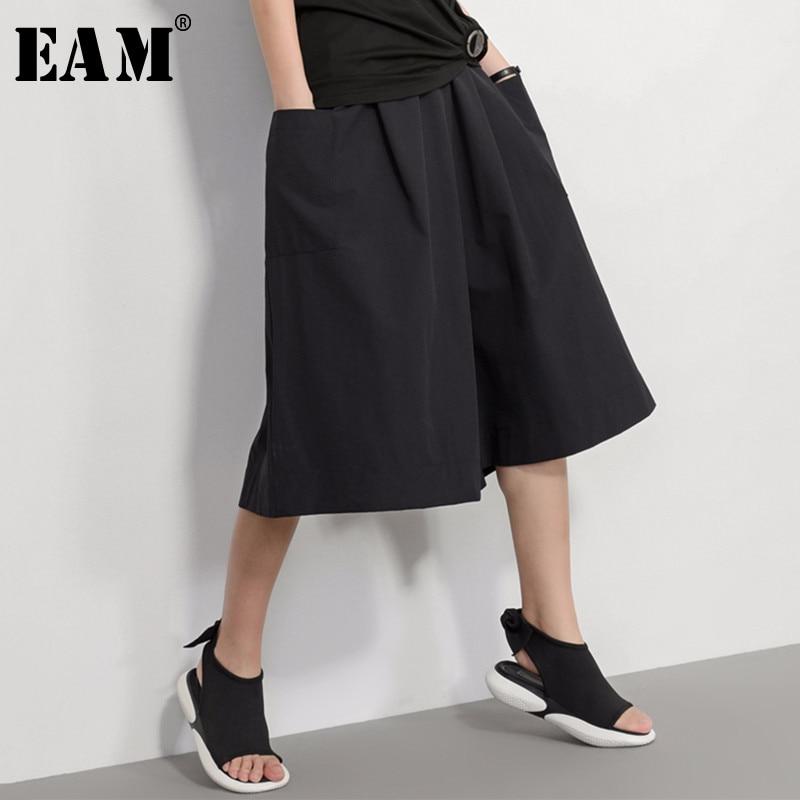 [EAM] 2019 New Autumn Winter High Elastic Waist Black Big Pocket Split Joint Loose Wide Leg Pants Women Trousers Fashion JU159