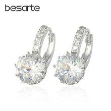Женские золотистые серьги кольца с цирконами фианитами и кристаллами