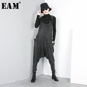 Image 1 - [EAM] 2020 nouveau printemps automne taille haute noir grande poche fendue Joint Harem jean pantalons amples femmes salopette mode JO51