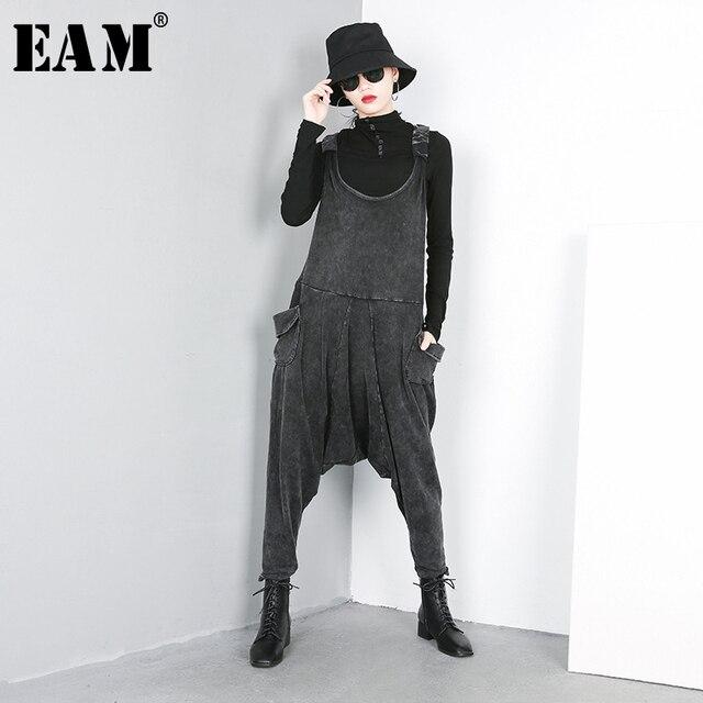 [EAM] 2020 nouveau printemps automne taille haute noir grande poche fendue Joint Harem jean pantalons amples femmes salopette mode JO51