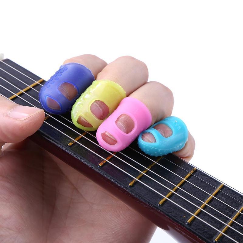 4 Stücke Silikon Gitarre Daumen Finger Picks Protector Fingertip Fingertip Fingerhut Finger Schutz Sicherheit Schützen Caps Farben Ausgewählt