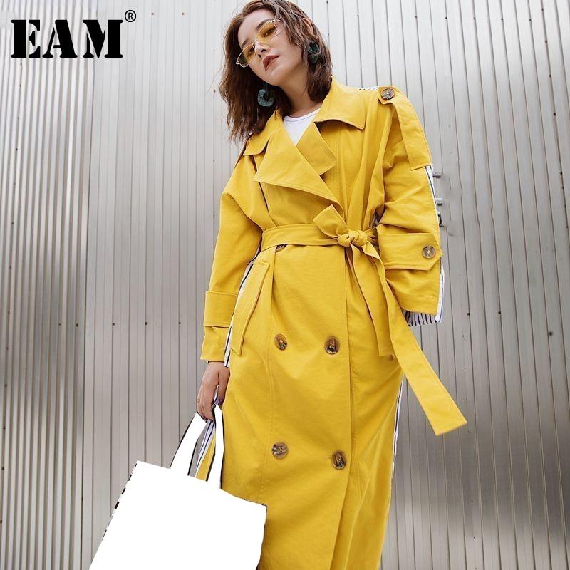 [EAM] 2019 New Autumn Winter Lapel Long Sleeve Denim Spliced Pockets Drawstring Pleated Windbreaker Women Trench Fashion JY724