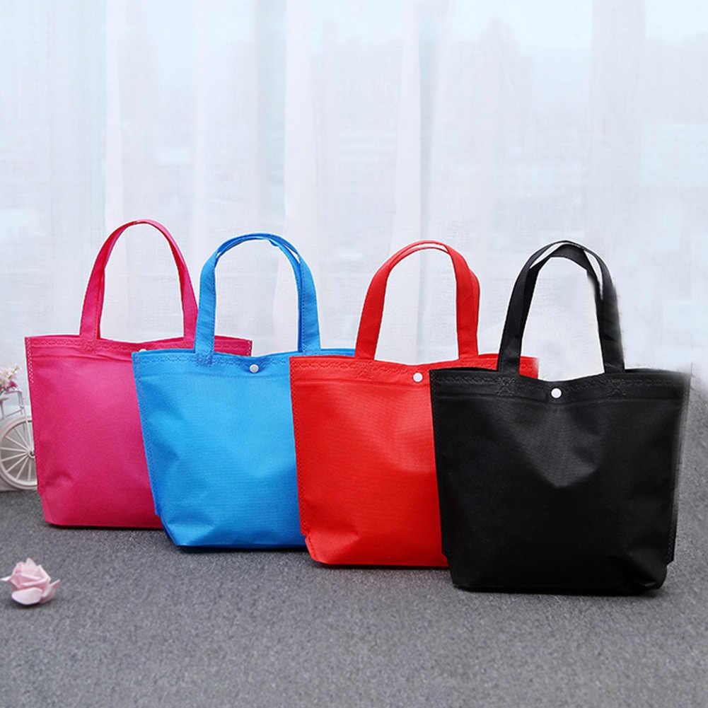 سعة كبيرة قابلة لإعادة الاستخدام غير المنسوجة أكياس التسوق عالية الجودة المرأة طوي زر حمل الحقيبة البقالة ايكو تخزين حقائب اليد