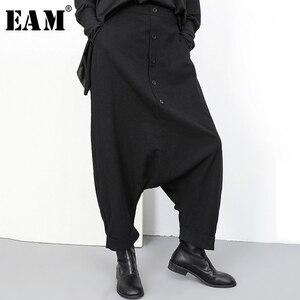 Image 1 - [EAM] جديد ربيع خريف 2020 عالي المرونة الخصر الأسود زر انقسام مشترك واسعة الساق السراويل الطويلة فضفاضة النساء بنطلون موضة YG2