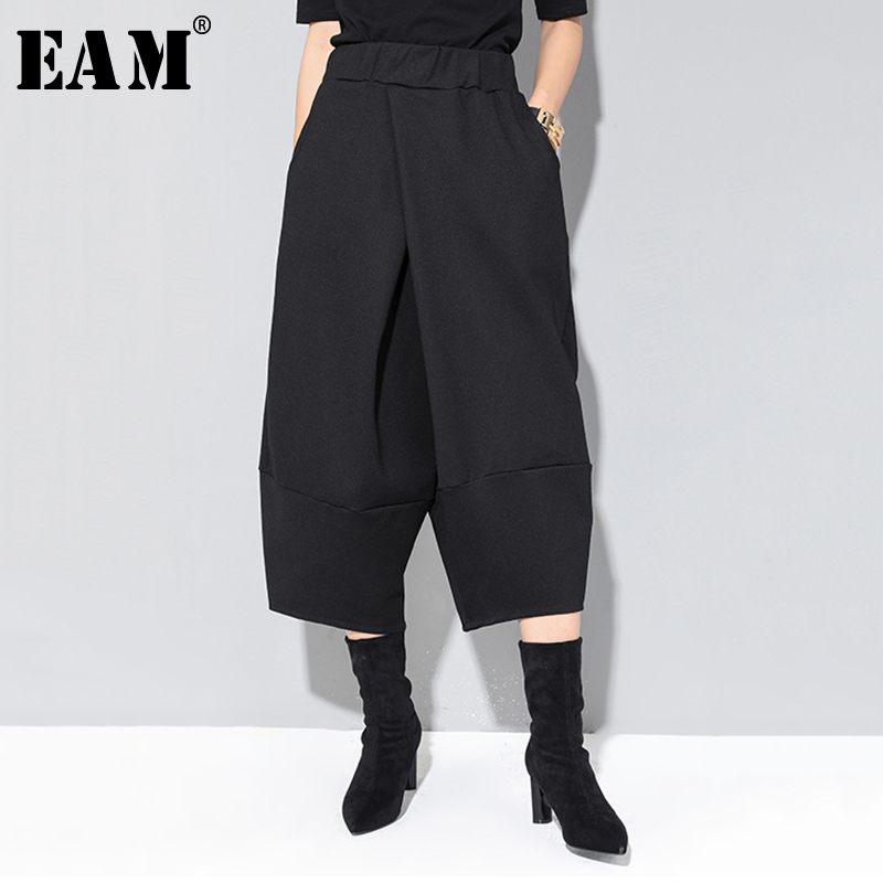 [EAM] 2019 New Autumn Winter High Elastic Waist Black Loose Big Pocket Brief Loose Harem Pants Women Trousers Fashion Tide JQ012