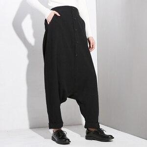 Image 3 - EAM Pantalones cruzados para mujer, pantalón negro, con cintura alta elástica, con botones divididos, finos, modernos, YG25, primavera y otoño, 2020