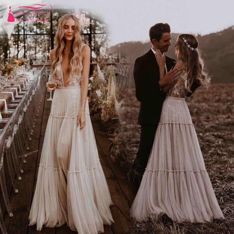 a56f011276f5 Nude Champagne Wedding Dresses 2019 Deep V-Neck Whimsical Boho Dreamy Bridal  Gowns Sexy Beach