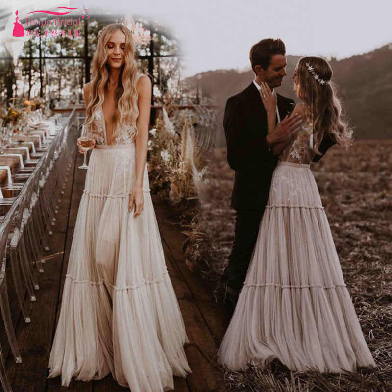 Nude Champagne Wedding Dresses 2019 Deep V-Neck Whimsical Boho Dreamy Bridal  Gowns Sexy Beach 42478a858946