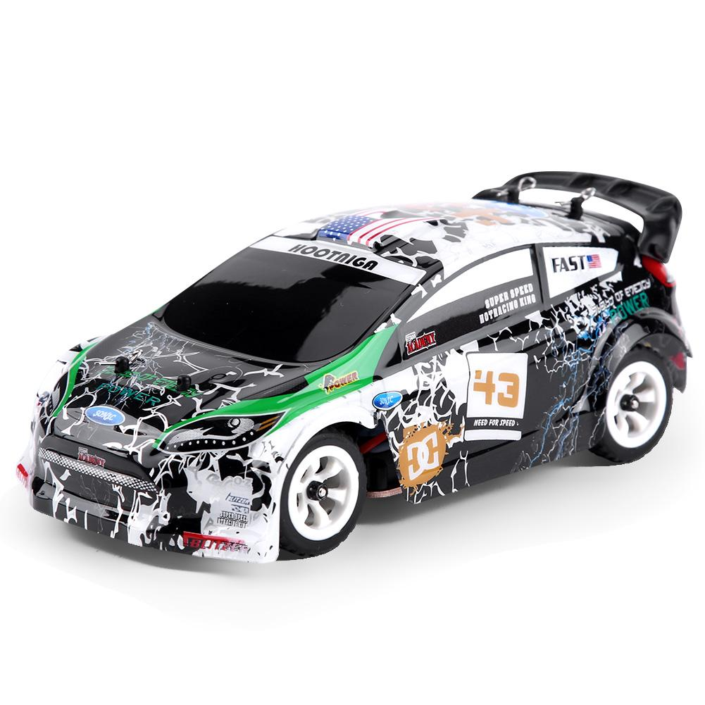 Wltoys K989 1/28 eléctrico 4WD vehículo todoterreno 2,4 GHz chasis de aleación RC coche 130 motor cepillado 30 km/h enchufe europeo para coche a través del país RC-in Coches RC from Juguetes y pasatiempos    1