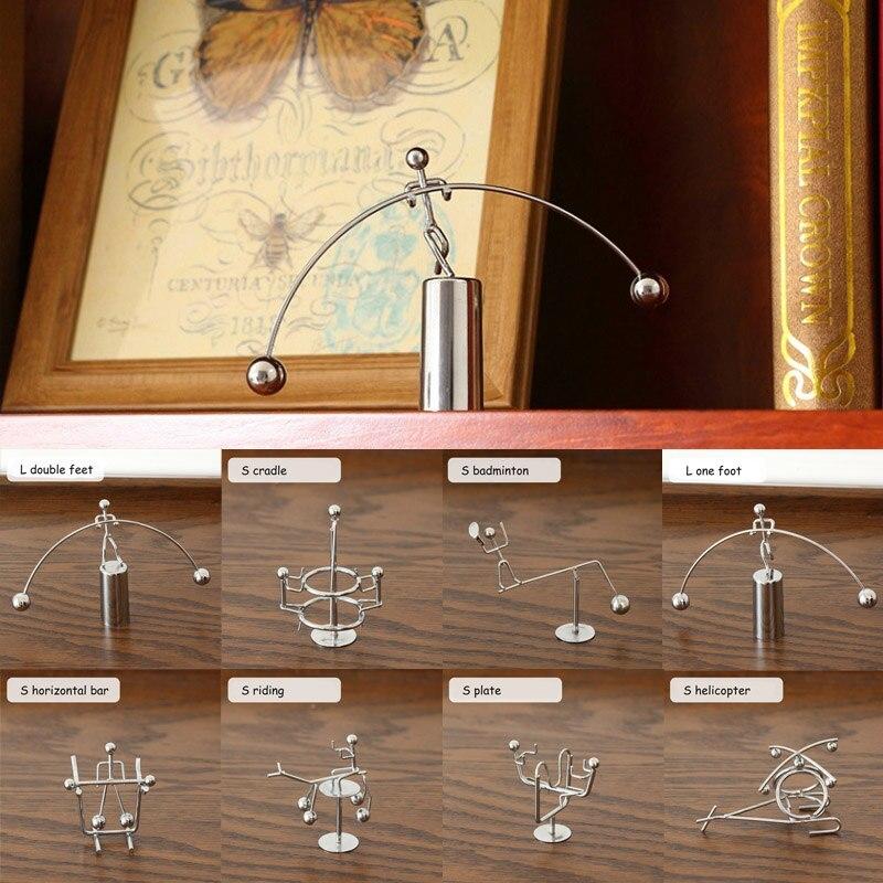 Metal hombre Hogar pequeño hombre de hierro equilibrio perpetuo péndulo de Ciencias Físicas Newton cuna escritorio juguete decoración del Hogar