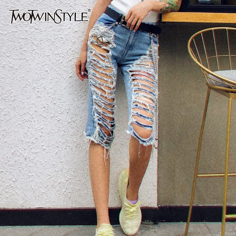 TWOTWINSTYLE Spring Ripped Hole Knee Length Denim Pants Women High Waist Irregular Slim Jeans Female Fashion 2020 Streetwear