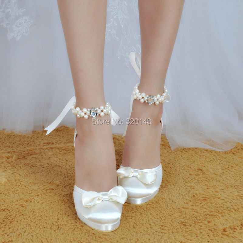 4ae567642644 Woman Shoes Wedding Bridal White Ivory High Heel Platform Round Toe Pearls  Ankle Strap Bow Satin Lady Prom Evening Pumps EP11074-in Women s Pumps from  Shoes ...