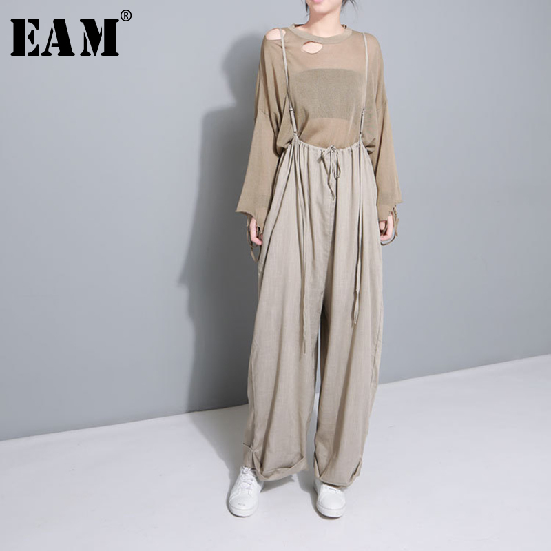 [EAM] 2019 New Spring Fashion Black Elastic Waist Loose Pleated Pockets Solid Color Woman Ankle-length Cross-pants SA085